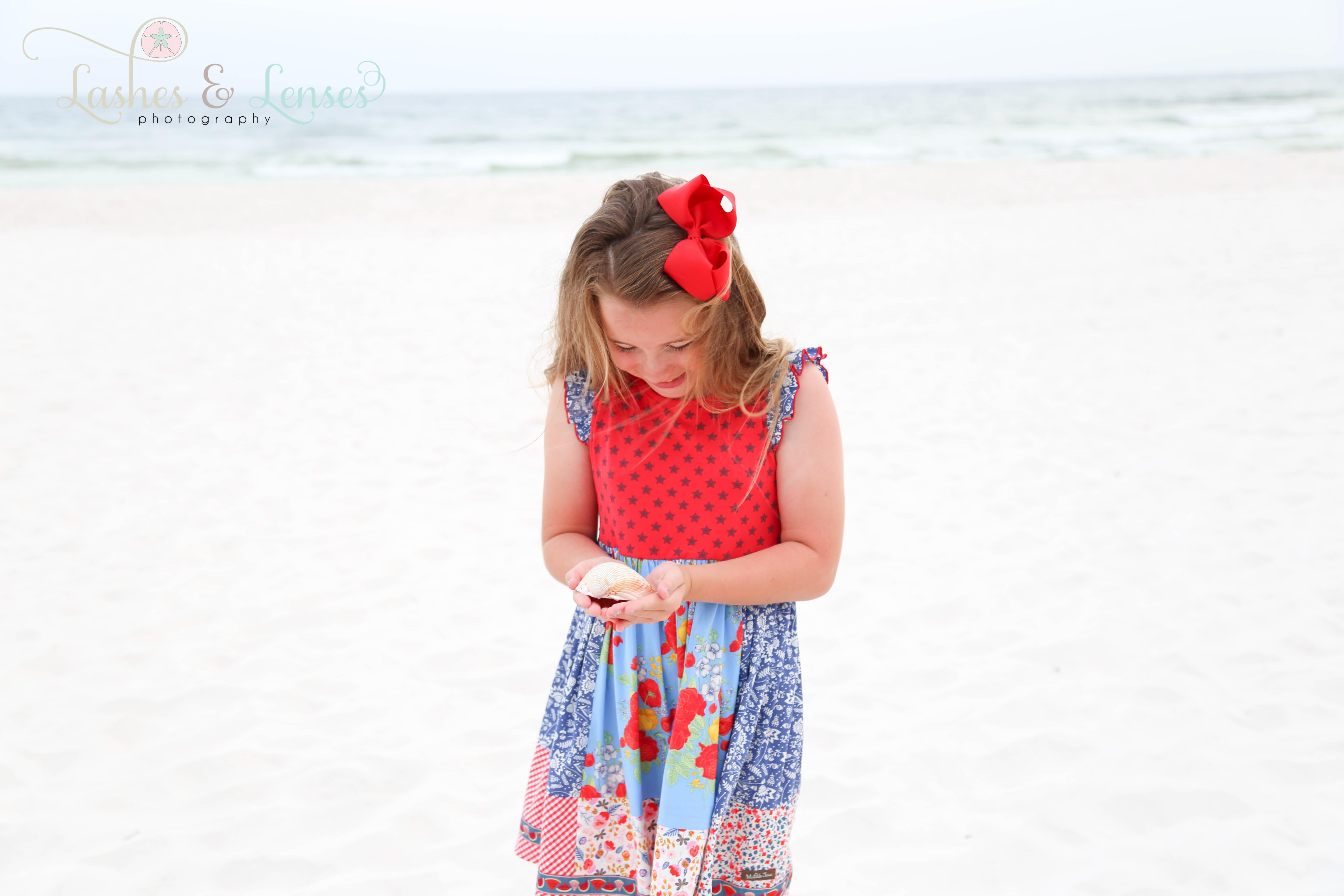 Little Girl with seashell on beach at Perdido Key Florida