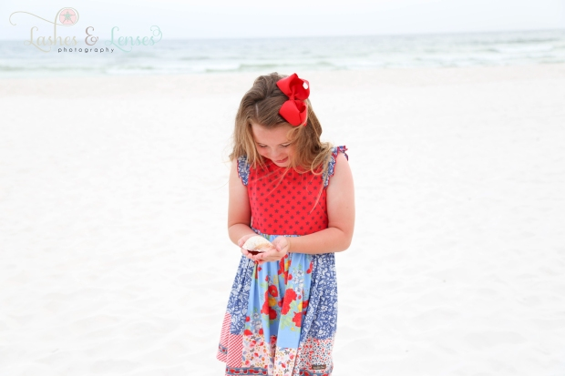 Little Girl with seashell on beach at Perdido Key Florida