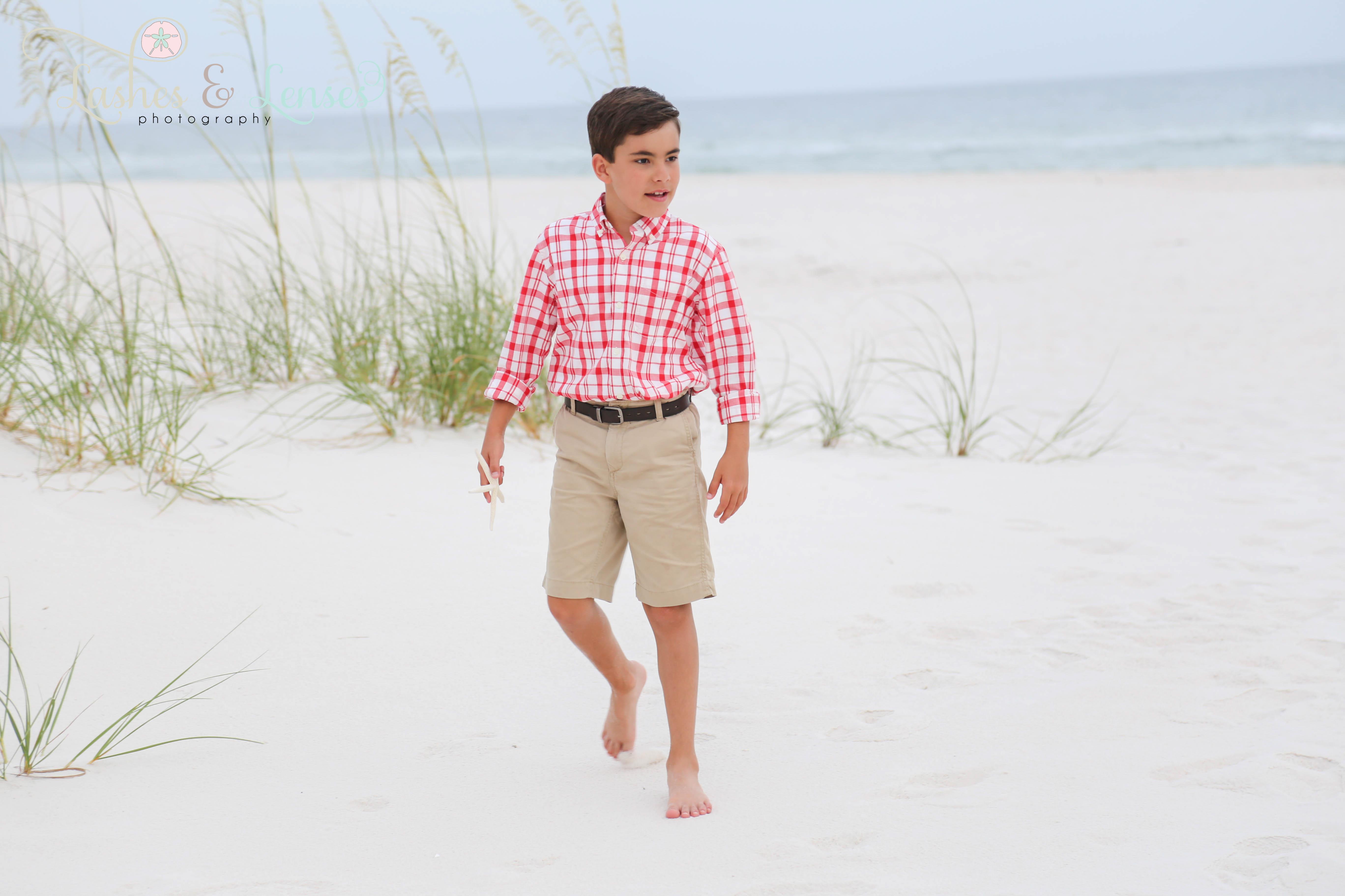 Little boy with seashell on beach at Perdido Key Florida