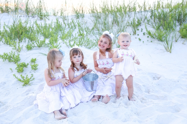 Little children sitting in the sand at Johnsons Beach Perdido Key