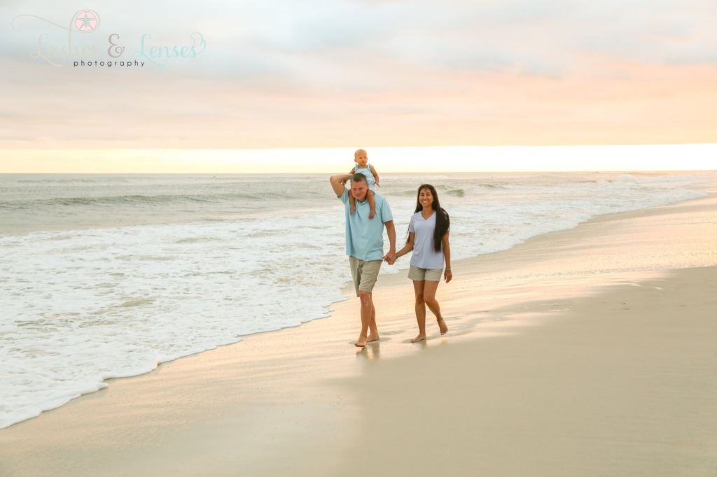 Parents photographed by water at Sunset at Johnsons Beach Perdido Key