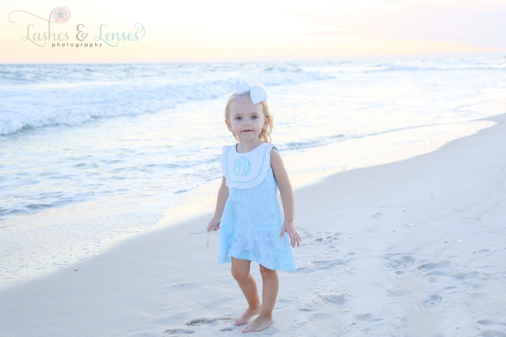 Little girl photographed by water at Johnsons Beach Perdido Key