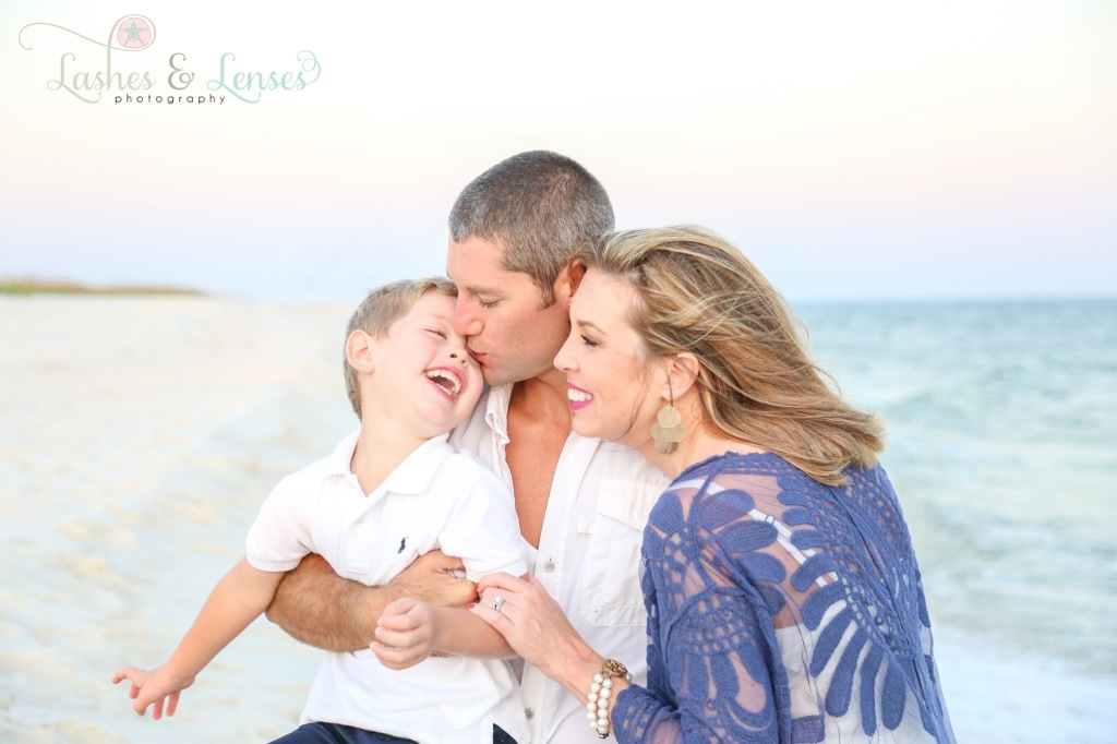Parents laughing with son photographed at Johnsons Beach Perdido Key