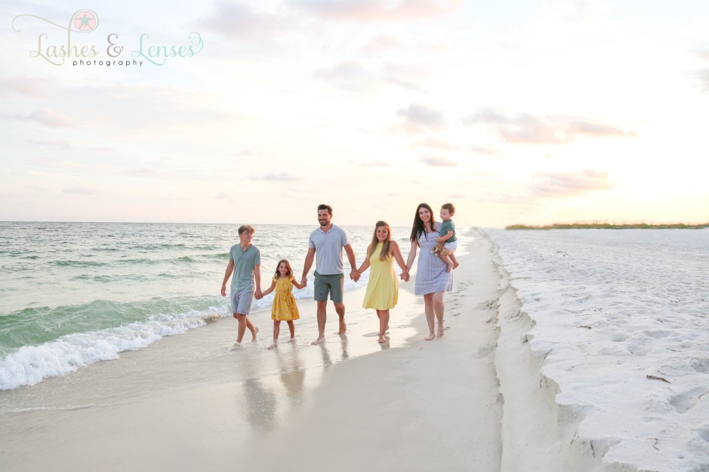 Large family walking by the water at Johnsons Beach Perdido Key