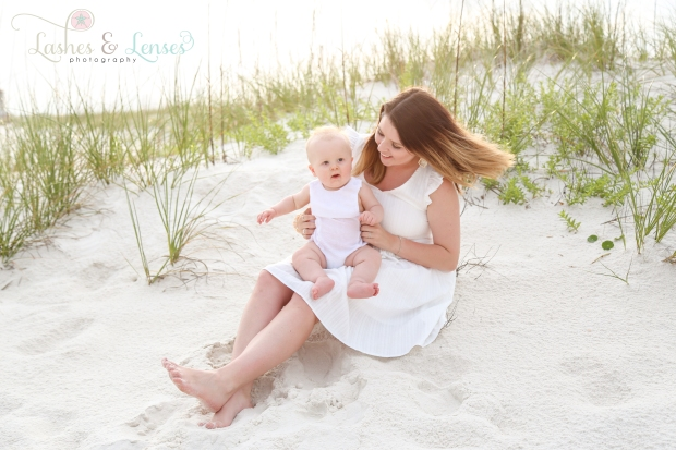 Mom and Baby sitting near sand dune