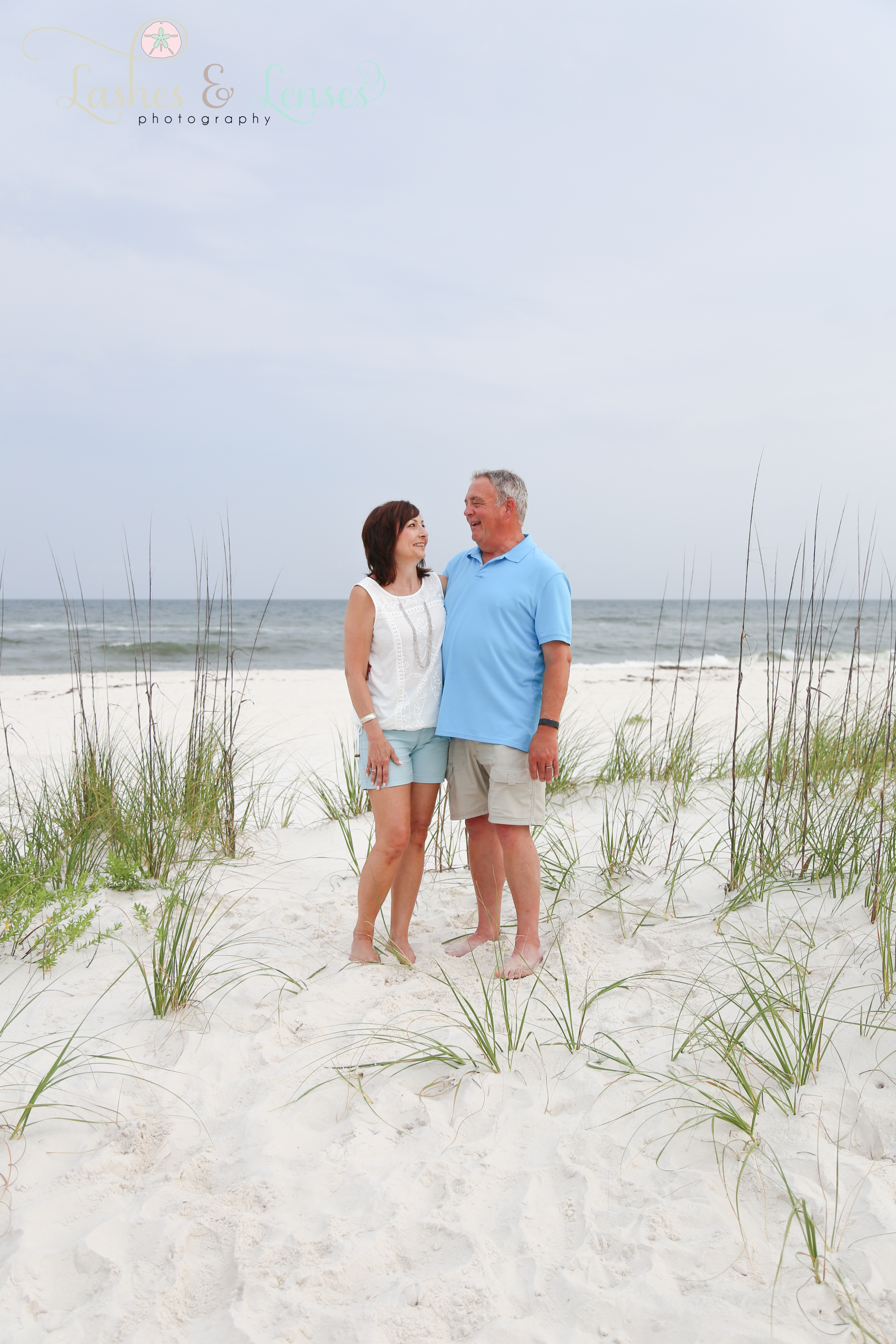 Couple standing near sand dune