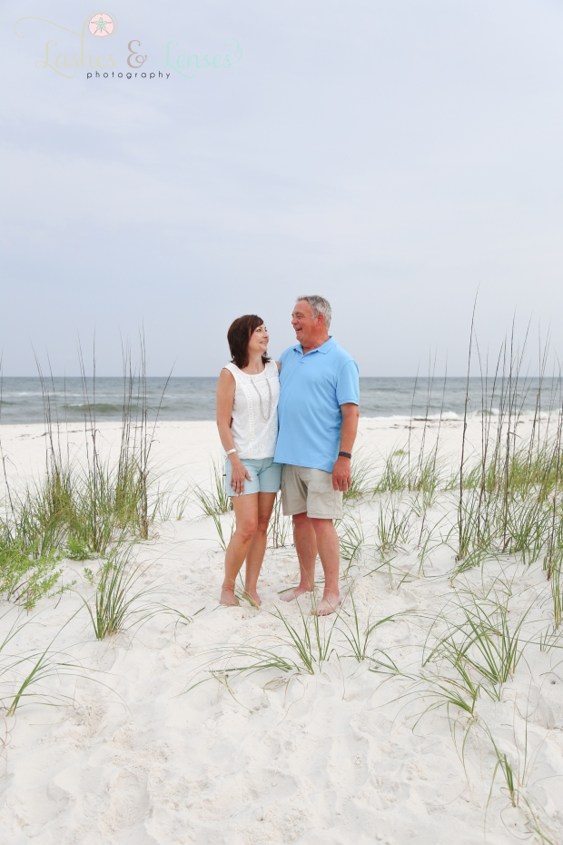 Couple standing near sand dune