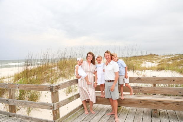 Family photographed on boardwalk at Johnsons Beach Perdido Key