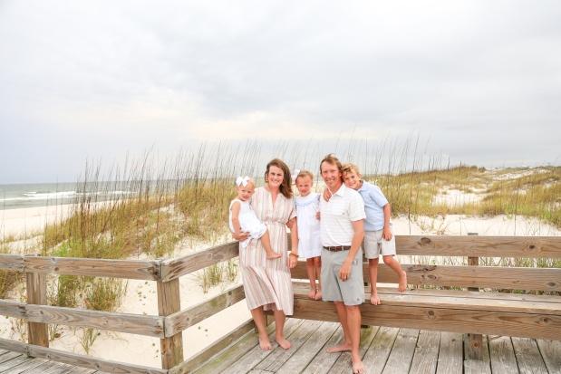 Family photographed on boardwalk at Johnsons Beach Perdido Key