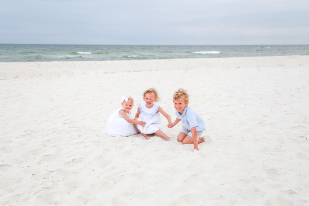 Children sitting on sand at Johnsons Beach Perdido Key