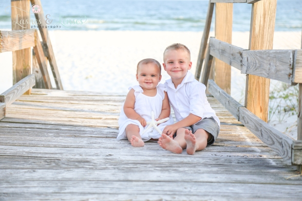 Little Boy and baby girl sitting on boardwalk at Johnsons Beach Perdido Key