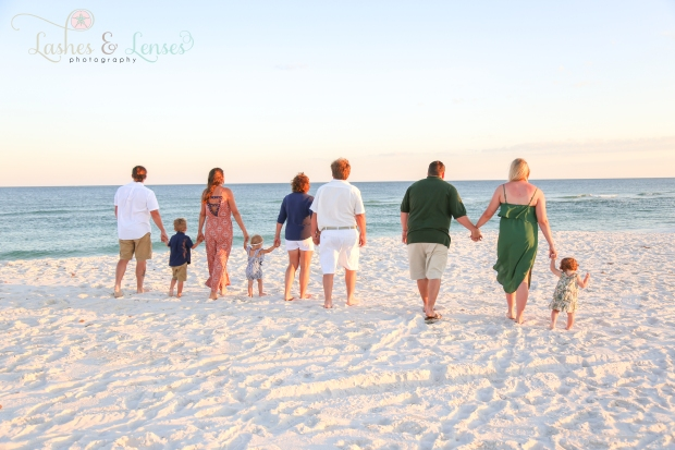 Large family walking down to water at Johnsons Beach Perdido Key