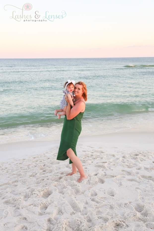 Mom and daughter by water at Johnsons Beach Perdido Key