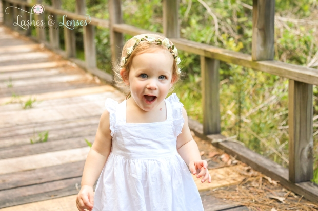 Baby girl laughing on nature walk