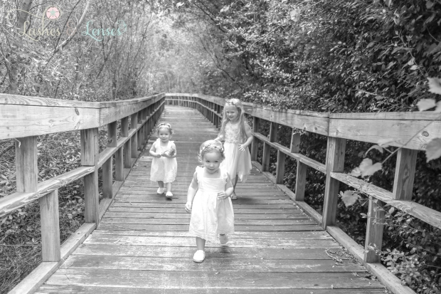 Twin baby girls and older sister on Nature walk