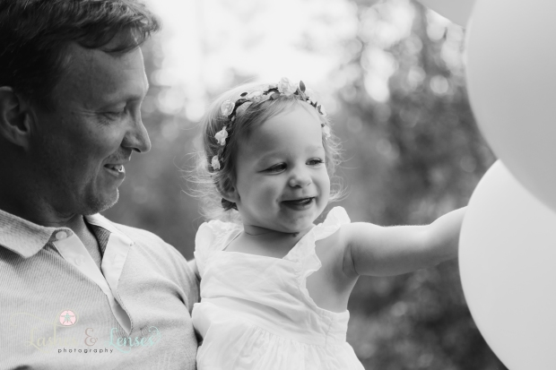 Dad and little girl with balloons