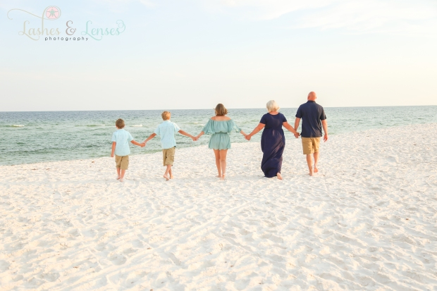 Family walking towards water at Johnsons Beach Perdido Key