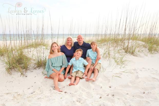 Family sitting in sand at Johnsons Beach Perdido Key