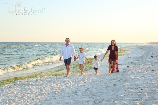 Family walking by water at Johnsons Beach Perdido Key