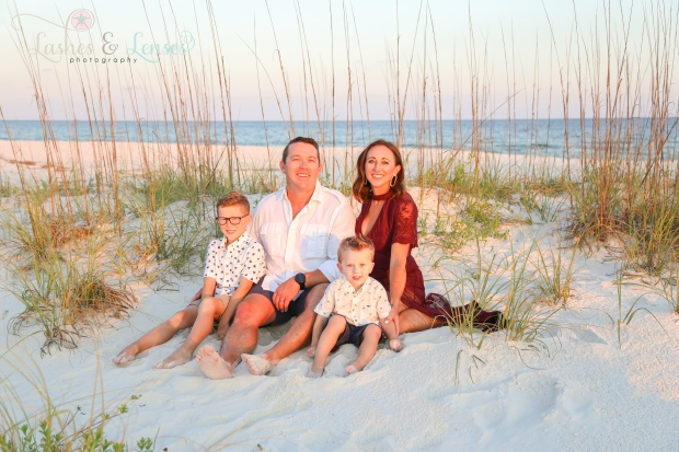 Family sitting in sand at Johnsons Beach Perdido Key