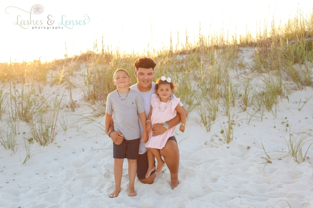 Big brother with little brother and sister in the sand at Johnsons Beach Perdido Key