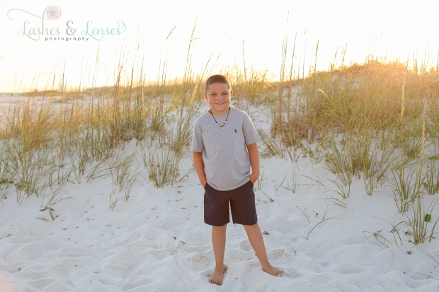 Young boy standing in the sand at Johnsons Beach Perdido Key