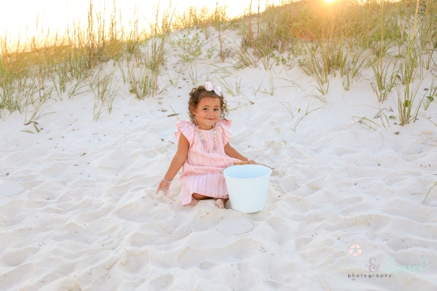 Toddler girl playing in sand at Johnsons Beach Perdido Key