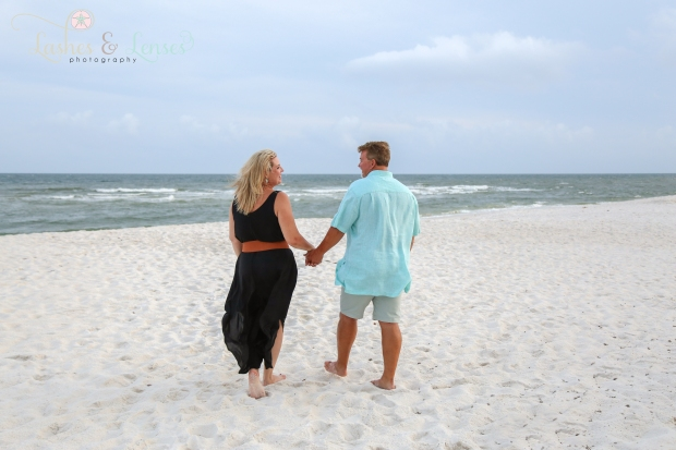 Husband and Wife walking in sand at Johnsons Beach Perdido Key