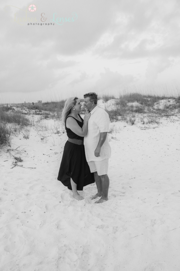 Husband and Wife kissing at Johnsons Beach Perdido Key