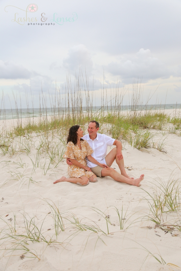 Couple sitting in the sand at Johnsons Beach Perdido Key