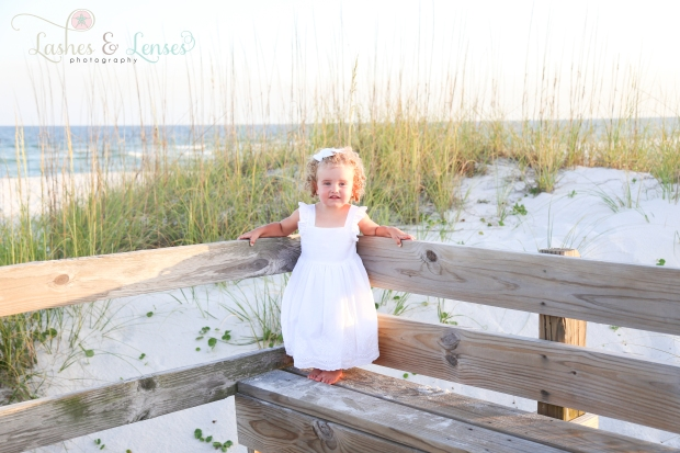 Toddler girl on bench at Johnsons Beach in Perdido Key