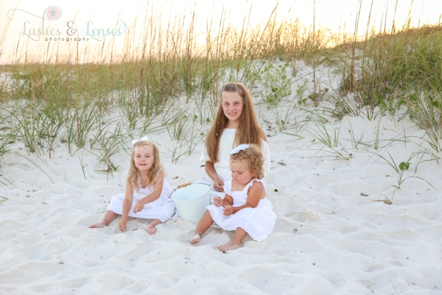 Sisters sitting on the sand at Johnsons Beach in Perdido Key