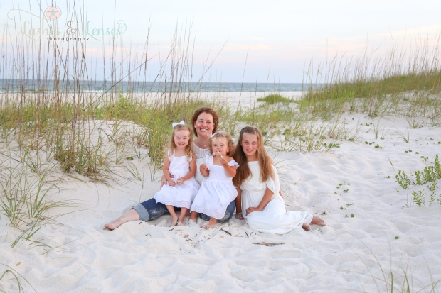 Mom and daughters sitting in the sand at Johnsons Beach in Perdido Key