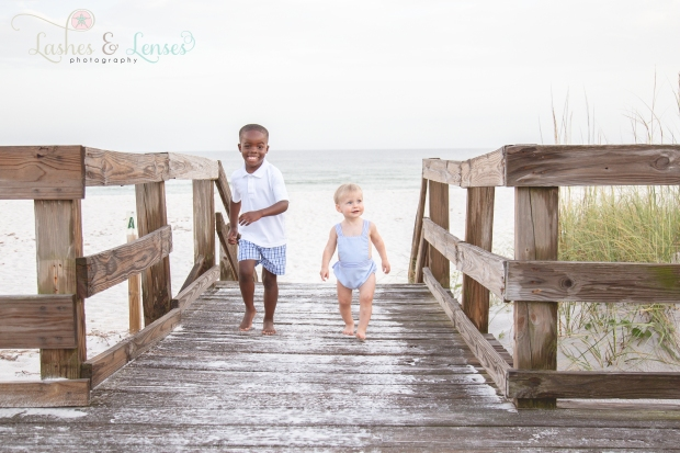 Brothers on the boardwalk at Johnsons Beach Perdido Key