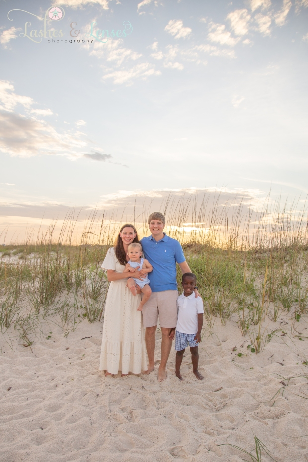 Family standing in the sand at Johnsons Beach Perdido Key