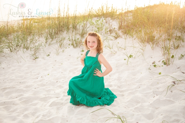 Little girl kneeling in the sand at Johnsons Beach Perdido Key