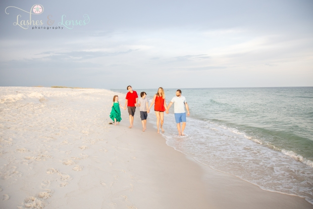 Family walking on the beach next to the water at Johnsons Beach Perdido Key