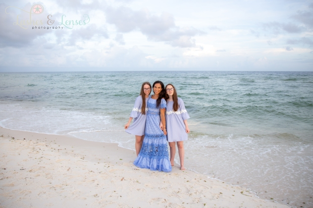 Mom with twin daughters by the water at Johnsons Beach Perdido Key