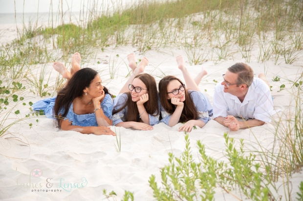 Family laying in the sand at Johnsons Beach Perdido Key