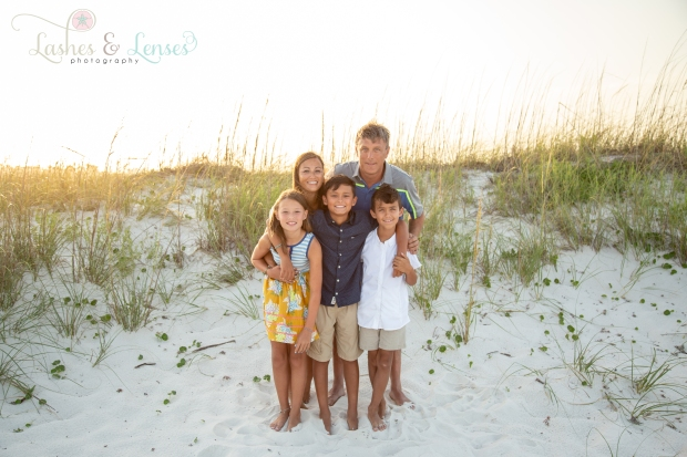 Family hugging on the beach at Johnsons Beach Perdido Key