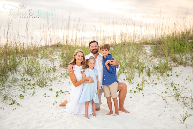 Family next to a sand dune at Johnsons Beach Perdido Key
