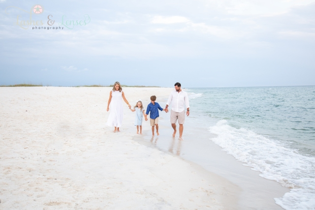 Family walking next to the water at Johnsons Beach Perdido Key