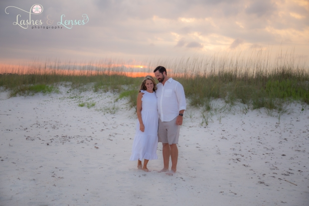 Couple with sunset behind them at Johnsons Beach Perdido Key
