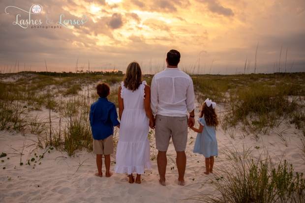 Family looking at sunset at Johnsons Beach Perdido Key
