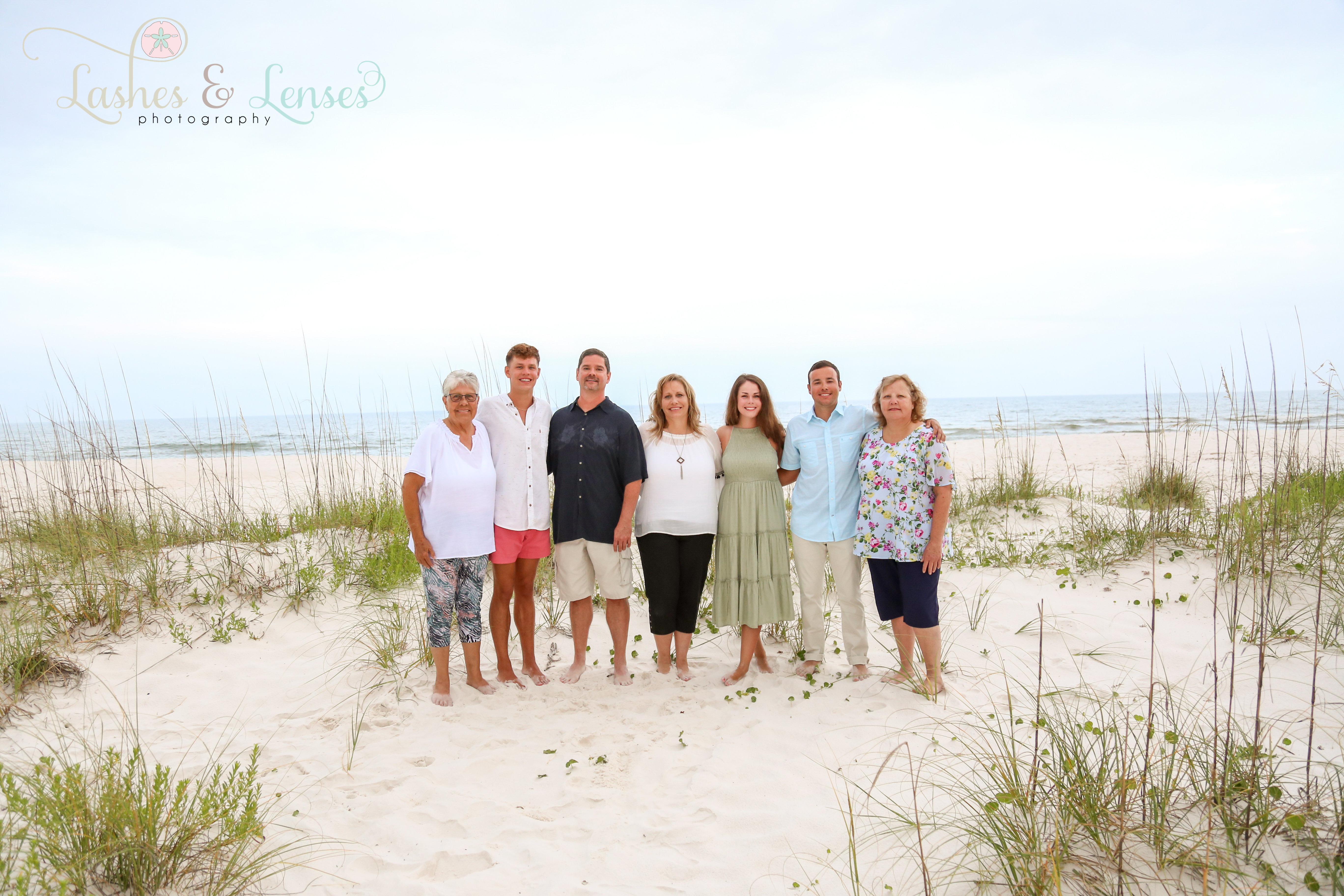 Large family standing in the sand at Johnsons Beach Perdido Key