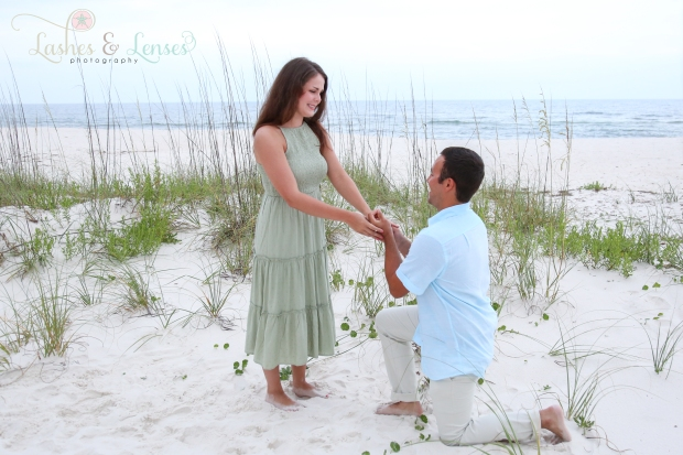 Man on one knee proposing to his girlfriend at Johnsons Beach Perdido Key
