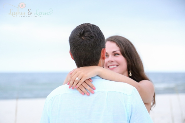 Close up of couple with water behind them at Johnsons Beach Perdido Key