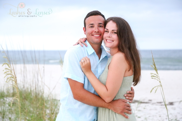 Couple hugging and facing the camera at Johnsons Beach Perdido Key