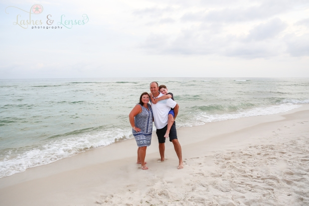 Parents with son by the water at Johnsons Beach Perdido Key