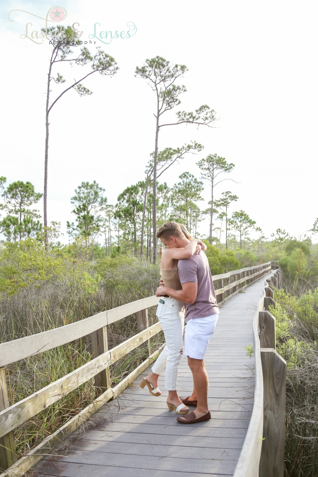 Young man proposing to girlfriend on nature trail at Johnsons Beach Perdido Key
